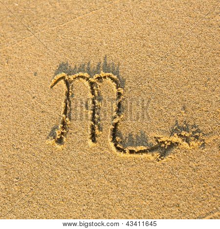 Zodiac sign Scorpio, drawn on the facture beach sand. (zodiac signs series)