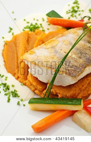 Fried Fish (Zander). Garnished with Lemon,  Sweet Mash and Vegetables