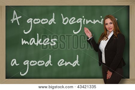 Teacher Showing A Good Beginning Makes A Good End On Blackboard