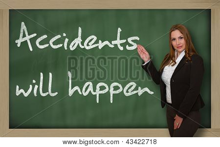 Teacher Showing Accidents Will Happen On Blackboard
