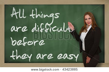 Teacher Showing All Things Are Difficult Before They Are Easy On Blackboard