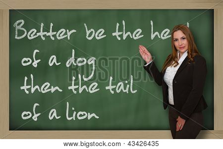 Teacher Showing Better Be The Head Of A Dog Then The Tail Of A Lion On Blackboard