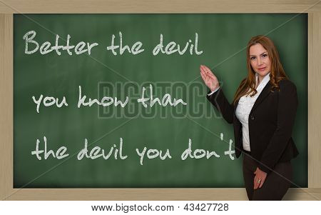 Teacher Showing  Better The Devil You Know Than The Devil You On Blackboard