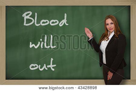 Teacher Showing Blood Will Out On Blackboard
