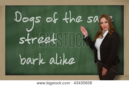 Teacher Showing Dogs Of The Same Street Bark Alike On Blackboard