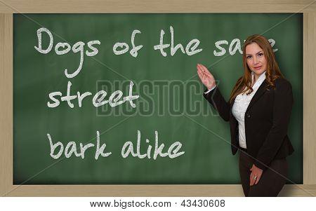 Teacher Showing Dogs Of The Same Street Bark Alike On Blackboard
