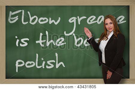Teacher Showing Elbow Grease Is The Best Polish On Blackboard