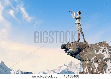 Business woman with telescope