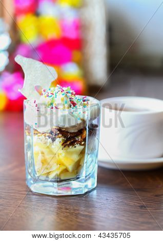 Fruit Dessert With Colorful Sprinkles & Cup Of Tea