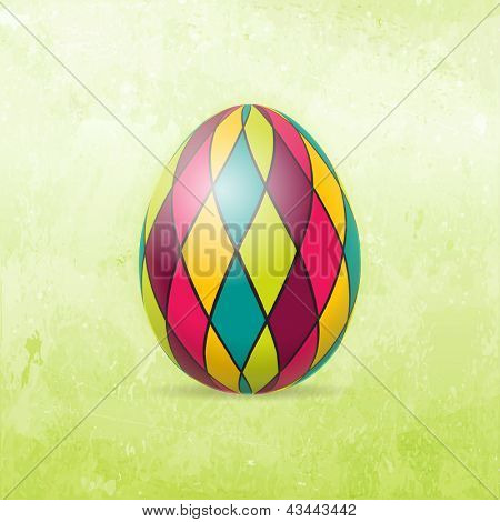 Checkered Easter egg in bright colors on distressed background in shades of light to dark spring green.