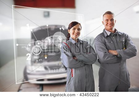 Two mechanics standing in front of a futuristic interface in a garage