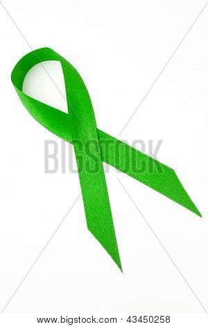 Green ribbon for awareness on white background
