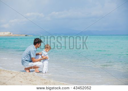 Father with his son on beach