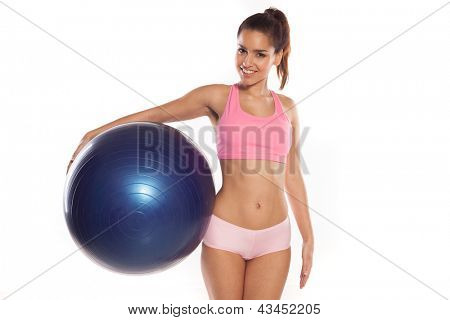 Fitness exercise woman holding Pilates ball ready for exercising