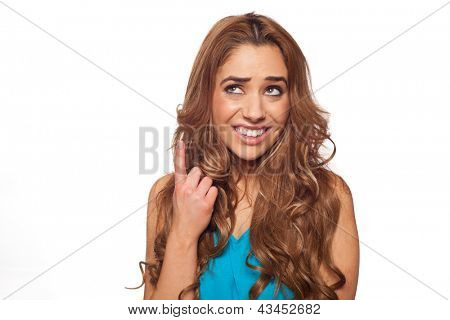 Portrait of brunette woman pointing and looking up on something