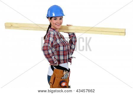 Woman with strips of wood on her shoulder