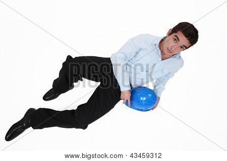 Casual young architect laying on the floor