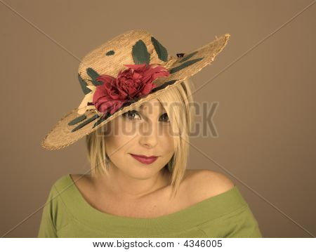 Blonde Flowered Hat Slanted Big Eyes