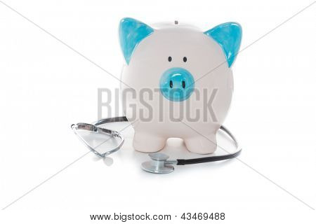 Stethoscope wrapped around blue and white hand painted piggy bank