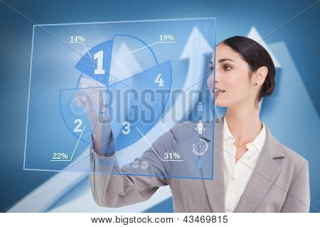 Smiling businesswoman using blue pie chart interface with arrows on background