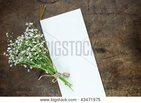 Bouquet of baby's breath (or Gypsophila), and a blank wedding or a party invitation card.