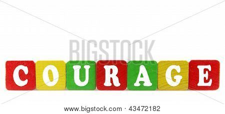 Courage - Isolated Text In Wooden Building Blocks
