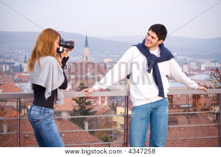 Young Couple Taking Pictures Of Each Other