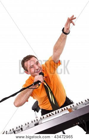 Joyful Singer With Synthesizer And Microphone