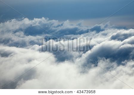 Above the clouds in the sky