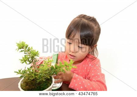 Smiling girl with plant