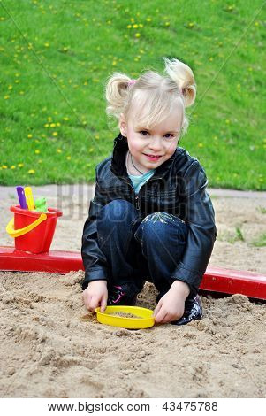 The Girl In The Sandbox