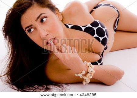 Side View Of Sensuous Model In Bikini Looking Aside