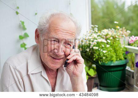 Pleased Senior Speaking On The Phone