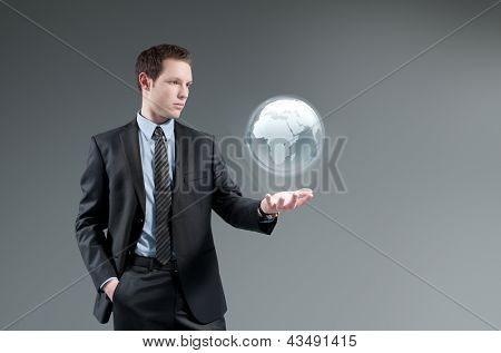 Man holding world globe Hologram. Future interface. Futuristic technology concept. Global business management.