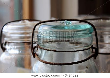 Old rusty tops of mason jars