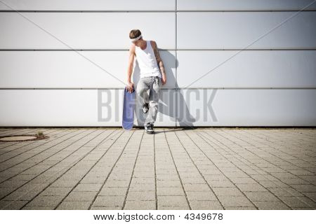 Skater Holding His Skateboard