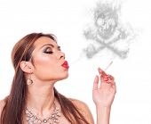 Mid age woman smoking and blowing smoke-skull, isolated on white