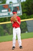 stock photo of little-league  - Nervous little league baseball player about to pitch the ball  - JPG