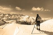 foto of snow-slide  - Old skier with traditional old wooden skis and backpack - JPG