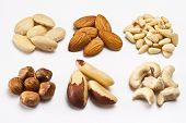 stock photo of brazil nut  - Almonds bleached almonds hazelnuts brazil nuts cashew nuts pine nuts - JPG