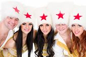 smiling dancer team wearing a cossack costumes