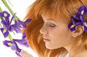 stock photo of beautiful young woman  - nice portrait of beautiful young model laying near violet flower - JPG