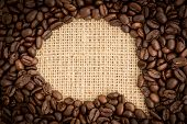 Coffee beans with speech bubble indent for copy space on burlap sack
