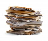 image of manila paper  - Files stacking up in a messy order isolated on white background - JPG