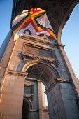 Flag in Triumphal Arch in Cinquantennaire Parc in Brussels , Belgium
