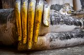 foto of chums  - Detail of beautiful golden hand of sitting Buddha in Wat Si Chum temple Sukhothai Thailand - JPG