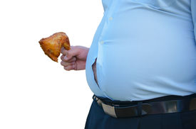 stock photo of bulging belly  - Fat man holding fried chicken with a fat stomach - JPG