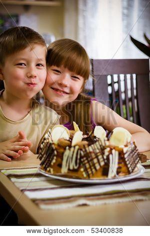 Children Eat A Cake