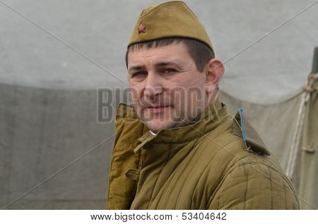 KIEV, UKRAINE -NOV 1  An unidentified member of Red Star history club wears historical Soviet uniform during historical reenactment of WWII, Battle for Kiev 1943 on November 1, 2013 in Kiev, Ukraine