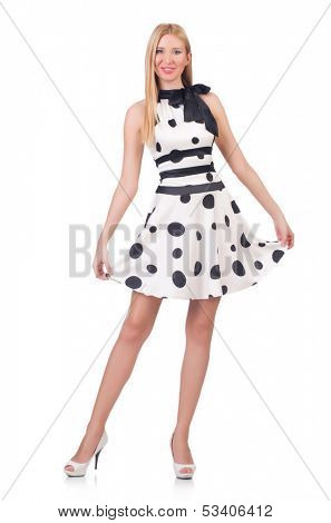 Tall model dressed in dress with polka dosts on white